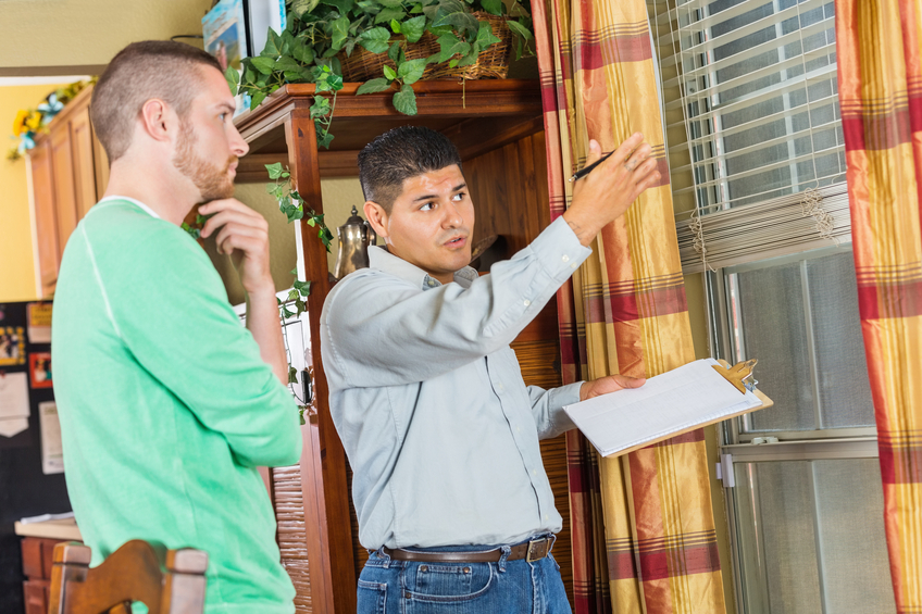 adjuster talking to an insured
