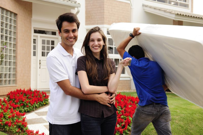 Young millennial couple moving into new home