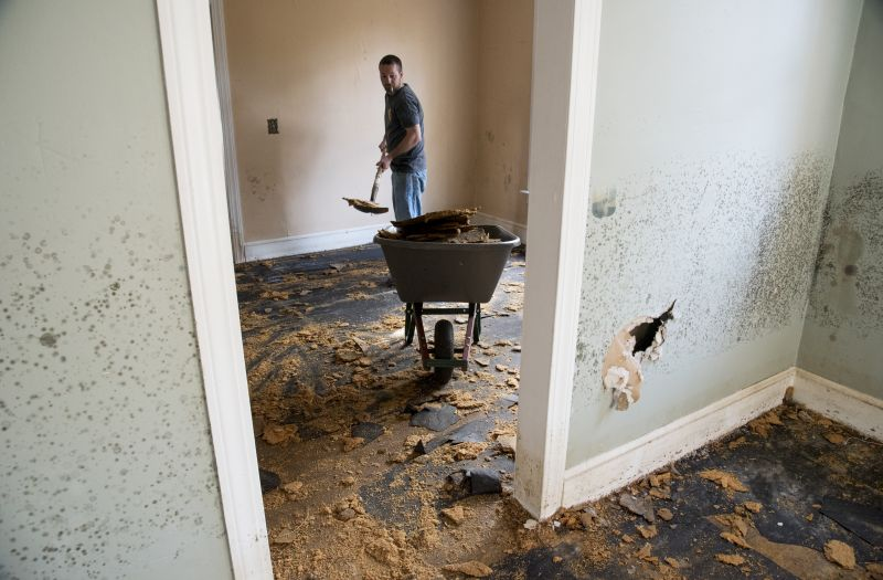 Brent Davis helps clean out a home that was heavily damaged by floodwaters caused by rain from Hurricane Matthew