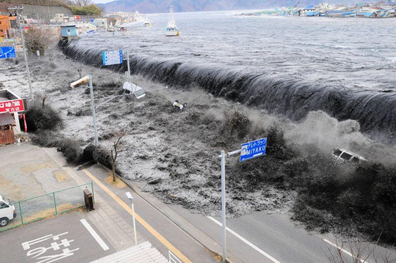 tsunami floods over the breakwater protecting Miyako Japan