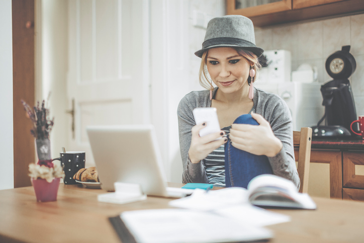 millennial woman using technology