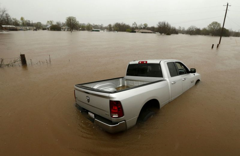 A partially submerged truck sits in rising floodwaters in Bossier Parish, La.