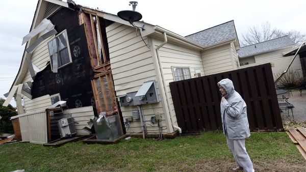 Connie Hall stands by her house as she looks at the damage Wednesday, March 1, 2017, in Franklin, Tenn., after a storm swept through the area. (AP Photo/Mark Zaleski)