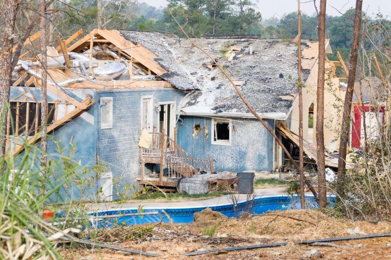 tornado damaged blue house