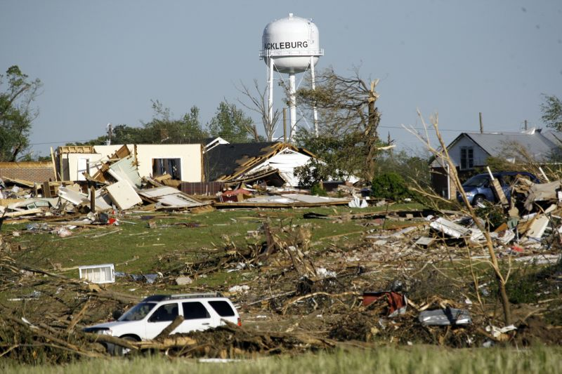 water tower stands amid tornado damage in Hackleburg, Ala.