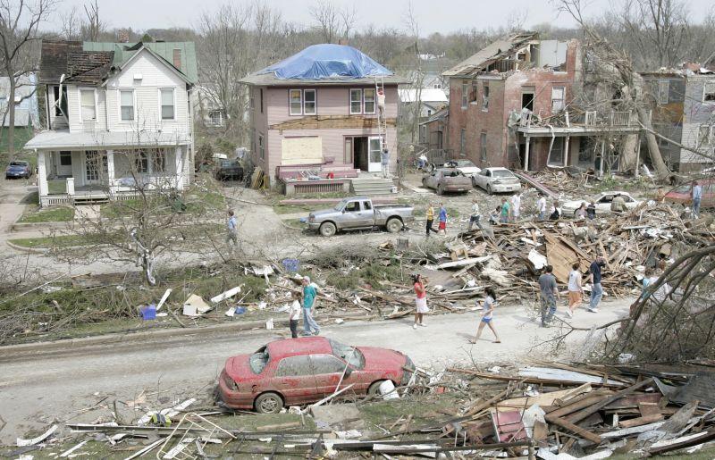 Workers cleanup houses in this tornado-damaged neighborhood