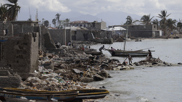Many houses in Haiti in the seaside fishing community lost their roofs and others were completely destroyed following the aftermath of Hurricane Matthew. (Source: AP Photo/Rebecca Blackwell)