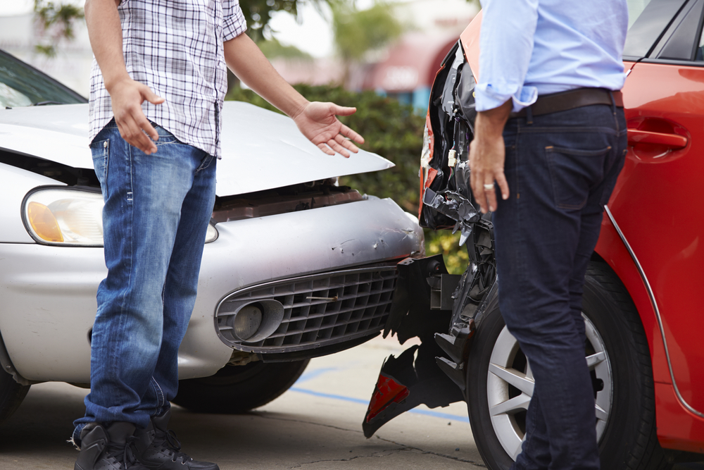 two men discussing an auto accident