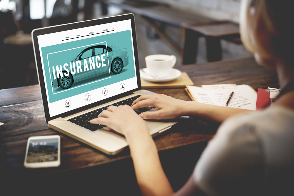 woman purchasing auto insurance online