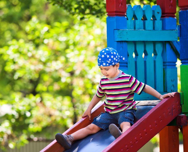 boy on playground slide