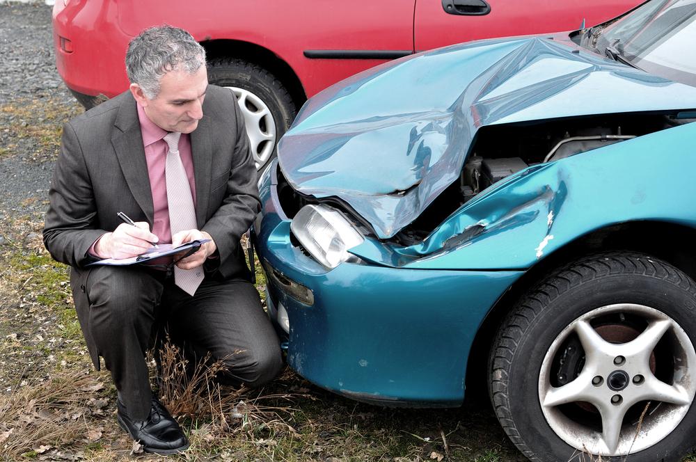 Insurance adjuster adjusting a claim