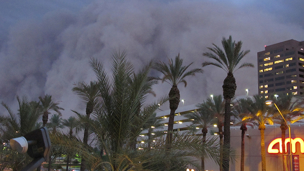 """A dust storm known as a """"haboob"""" rolls into downtown Phoenix on July 5, 2011, bringing strong winds and low visibility. Haboobs are part of Arizona's annual monsoon season, which is now in full swing. (AP Photo/Amanda Lee Myers)"""