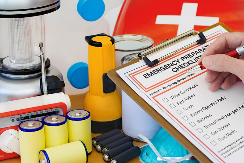 Hand completing emergency checklist