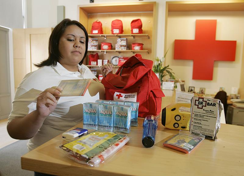 Woman preparing Red Cross survival kit