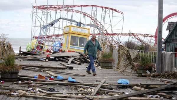 The Fun Town Pier in Seaside Heights was heavily damaged. Owner Billy Major surveys the damage Wednesday, Oct. 31, 2012. Only four of the rides on the pier survived superstorm Sandy. (AP Photo/Star-Ledger, David Gard/POOL)