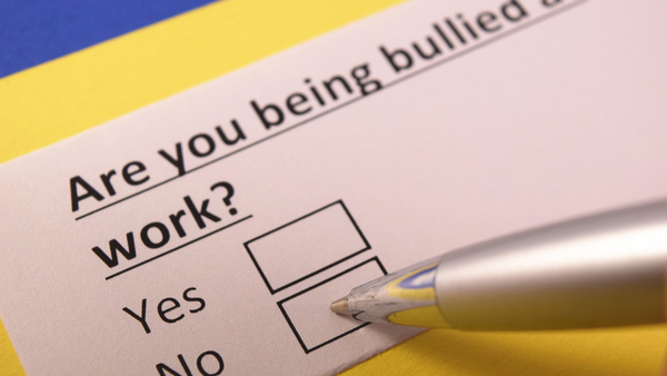 Businesses should have a written policy that addresses bullying and how to report it. (Photo: Shutterstock)