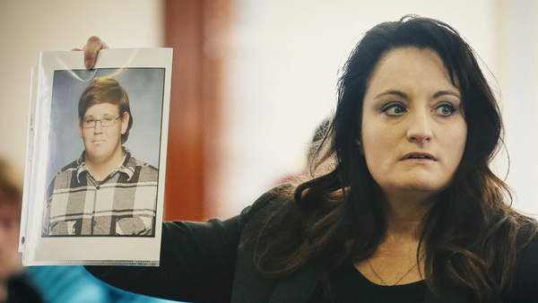 Special prosecutor April Wilson holds a photograph of Kenneth Suttner, January 31, 2017. (Photo: Timothy Tai/Columbia Daily Tribune)