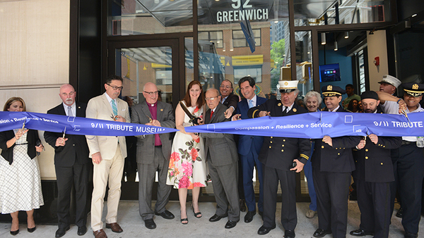 9/11 Tribute Museum Co-Founders Jennifer Adams-Webb and Lee Ielpi, center, cut the ribbon to the museum's new location with other dignitaries on June 13, 2017. (Photo: David Handschuh)