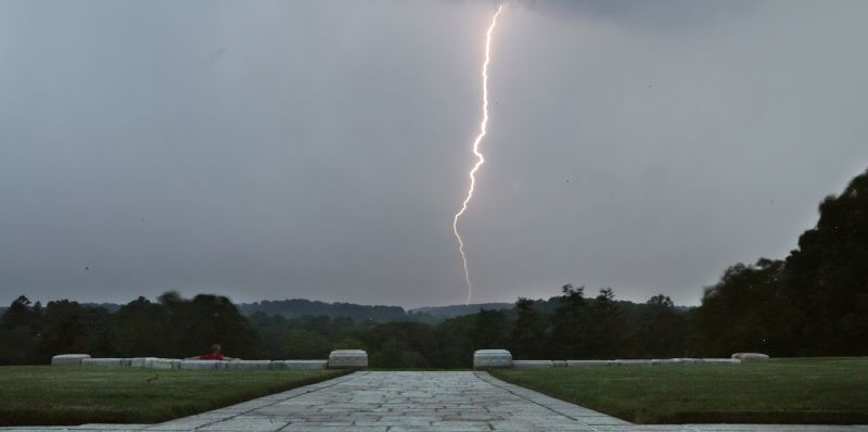 A bolt of lightning strikes the ground