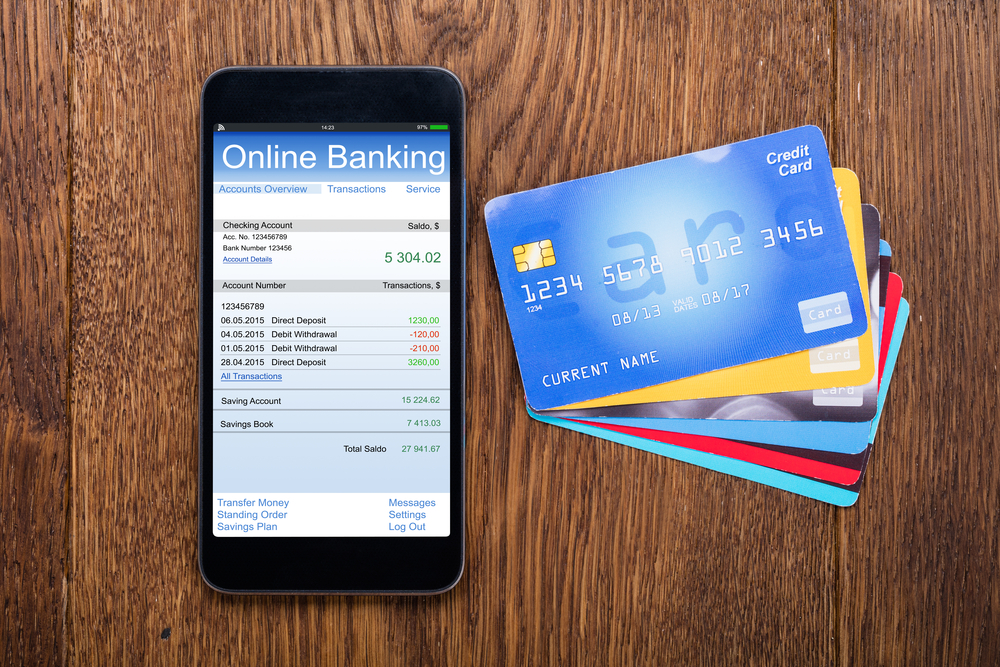 Online banking on smartphone with credit cards