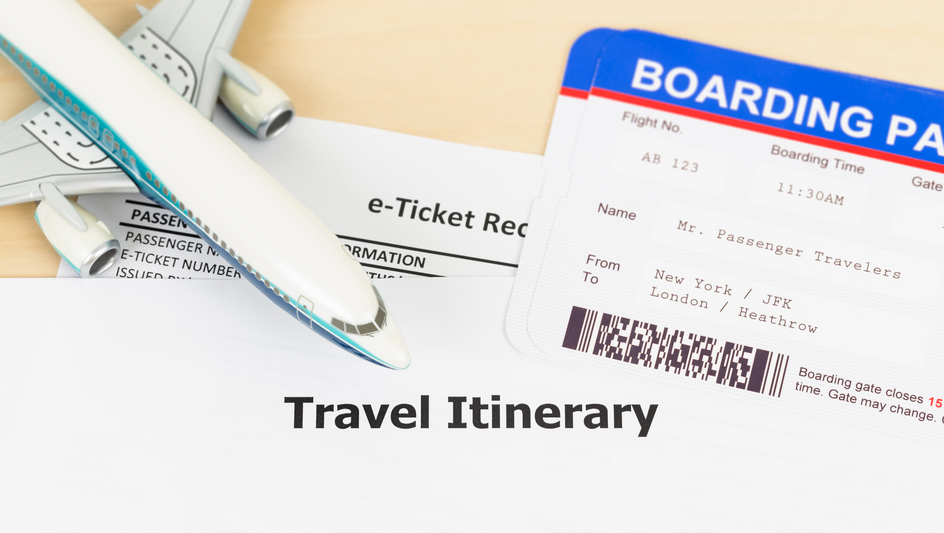 Travel itinerary, boarding pass and model plane