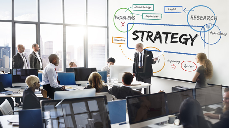 Business group meeting with word strategy on white board