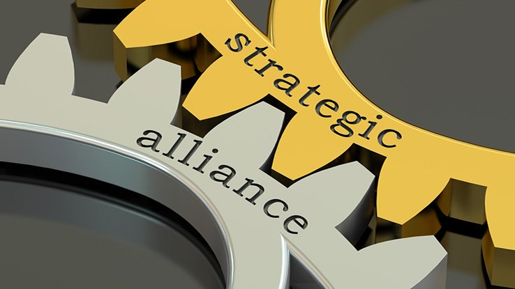 Interlocking gears with the words strategic alliance