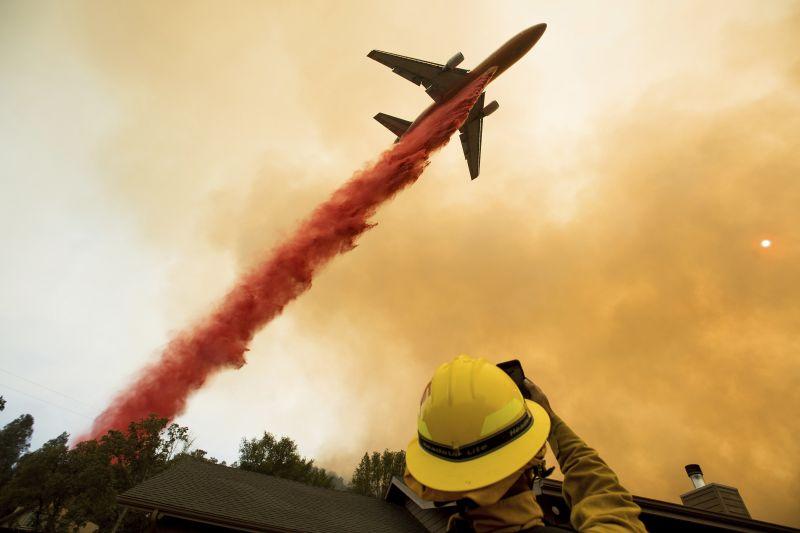 An air tanker drops retardant while battling a wildfire near Mariposa, Calif