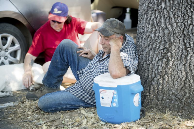 wildfire evacuees rest outside a Red Cross center for Detwiler fire evacuees in Oakhurst, Calif.