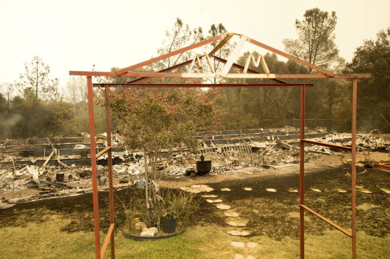 A trellis rests in front of a Hummingbird Lane residence leveled by the Detwiler fire