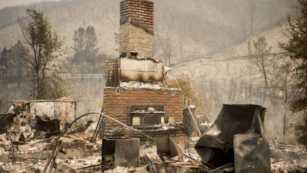 A chimney stands at a burned residence on Yaqui Gulch Road as a wildfire burns near Mariposa, Calif., on Wednesday, July 19, 2017. (AP Photo/Noah Berger)
