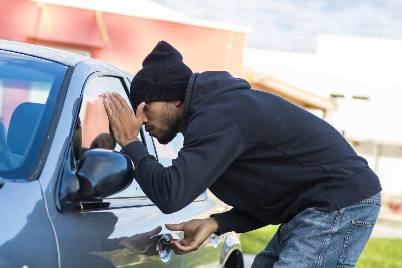 Man looking into car interior