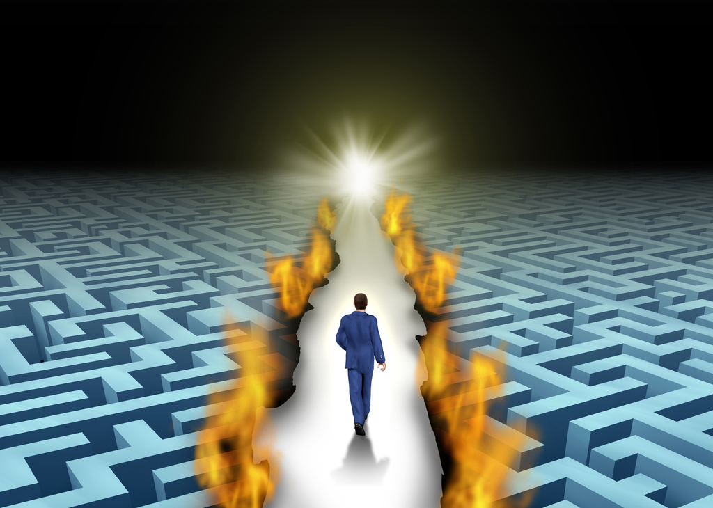 man traversing a maze that's on fire