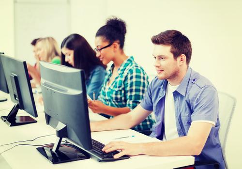 millennials working on computers