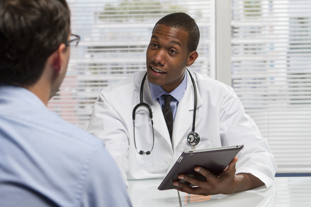 Physician talking to a patient