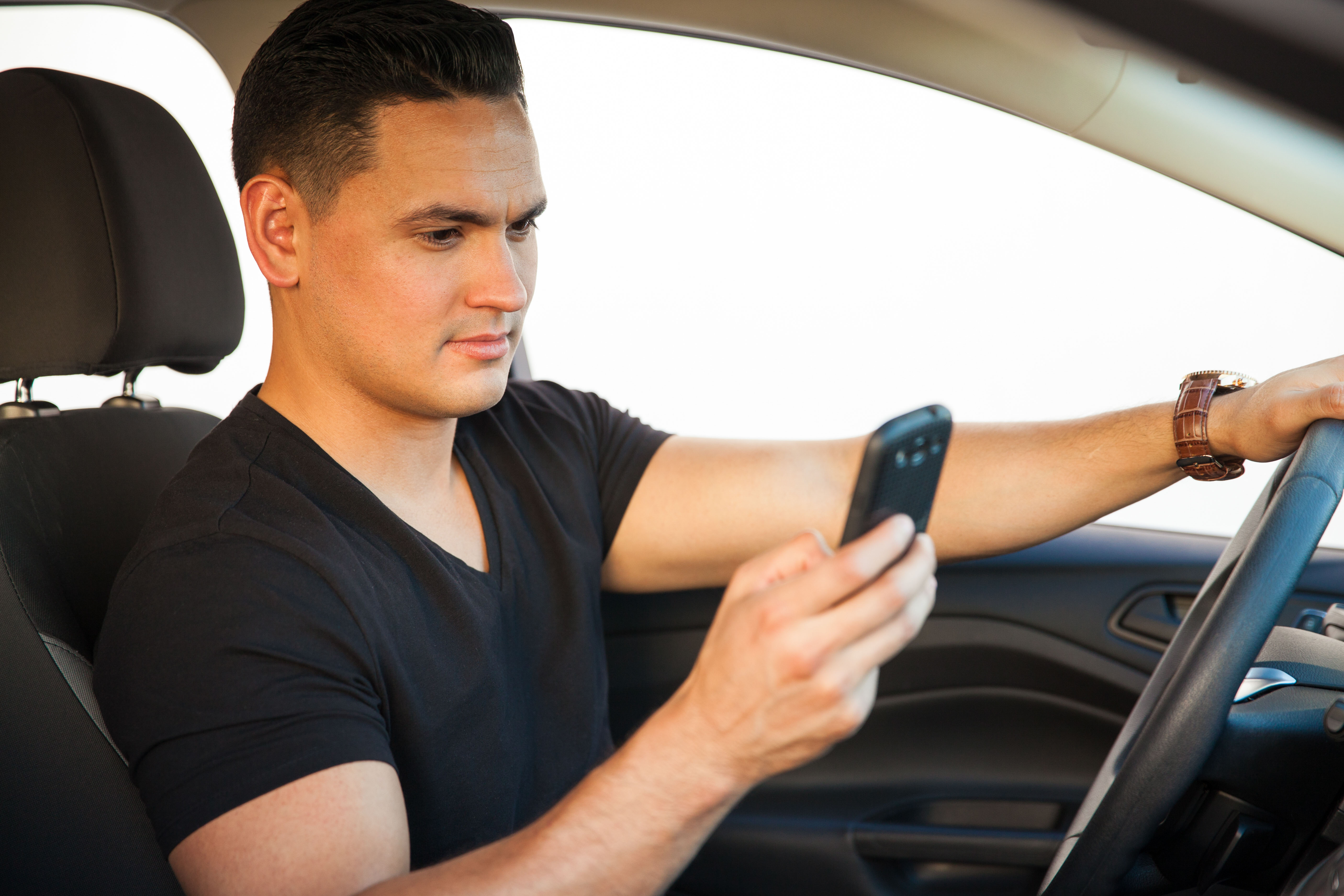 Man driving cell phone