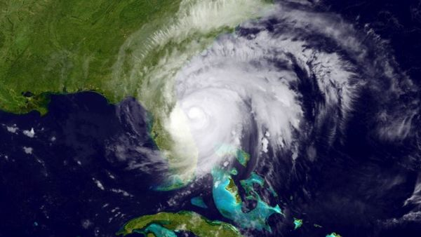 This satellite image provided by the NOAA, shows Hurricane Matthew moving past Florida's Atlantic coast early Friday, Oct. 7, 2016. (NOAA via AP)