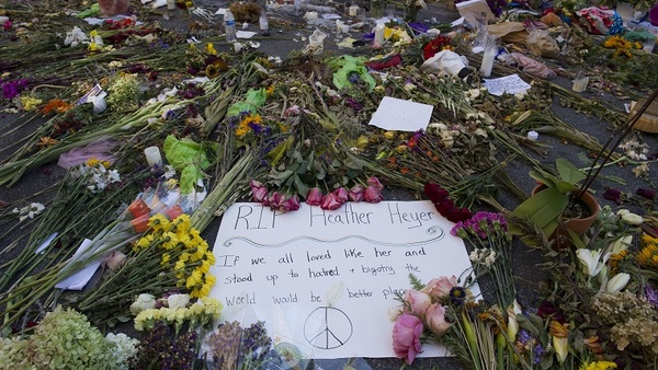 There simply isn't an insurance policy that covers loss of business due to the public's fear to return to a location because of recent civil unrest. Here, notes and flowers form a memorial in the streets of Charlottesville, Va., in honor Heather Heyer, who was killed while protesting a white nationalist rally there. (AP Photo/Cliff Owen)