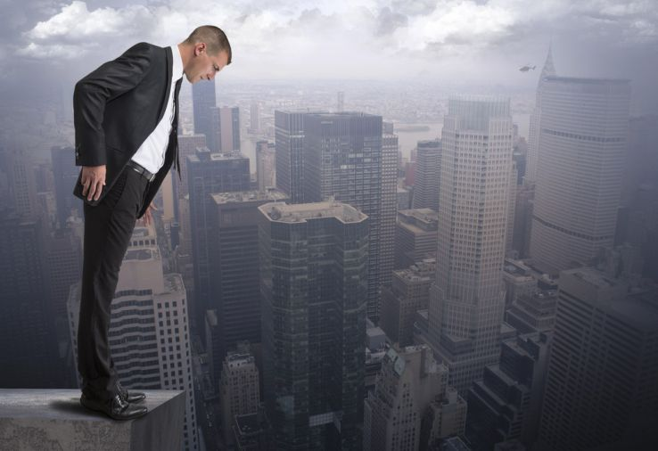businessman look off ledge of building