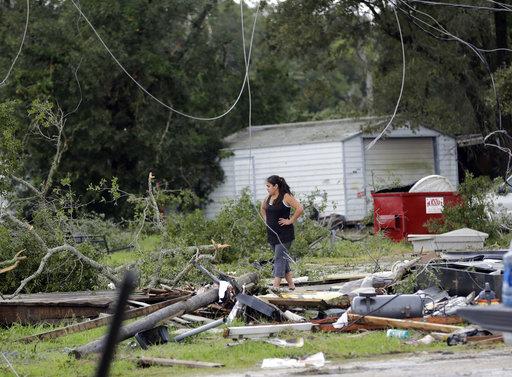 Woman surveys damage after Hurricane Harvey