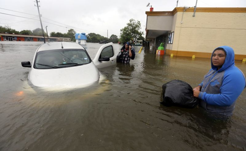 r became stuck in rising floodwaters from Tropical Storm Harvey in Houston, Texas