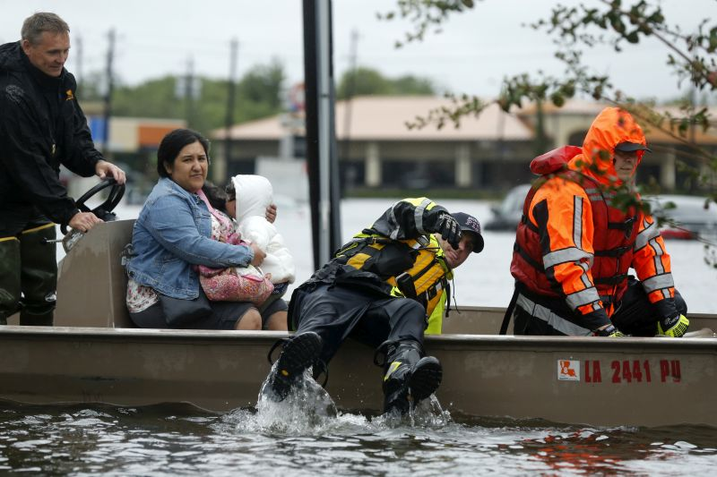 rescuing stranded residents during flooding from Tropical Storm Harvey