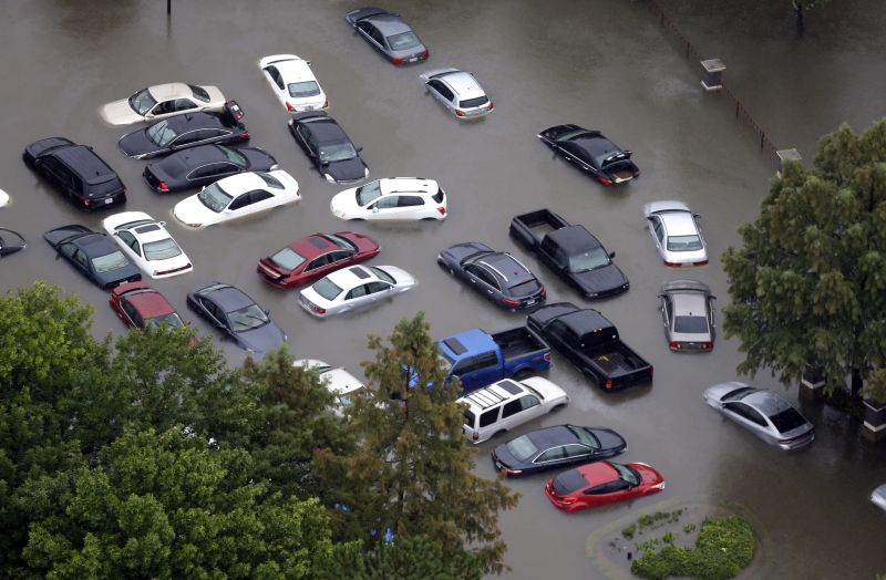 Flooded cars near the Addicks Reservoir are shown as floodwaters from Tropical Storm Harvey