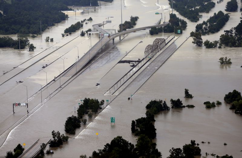 Interstate 69 is covered by floodwaters at the San Jacinto River bridge