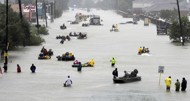 Rescue boats fill a flooded street