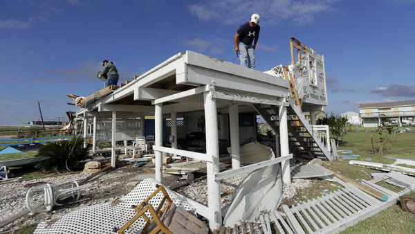 Joe Tijerina, right, works to salvage items from his home that was destroyed in the wake of Hurricane Harvey, Tuesday, Aug. 29, 2017, in Rockport, Texas. (AP Photo/Eric Gay)