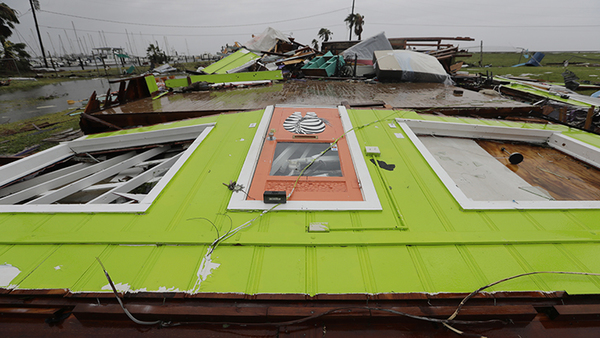 A business was wiped off its foundation in the wake of Hurricane Harvey, Saturday, Aug. 26, 2017, in Rockport, Texas. (AP Photo/Eric Gay)