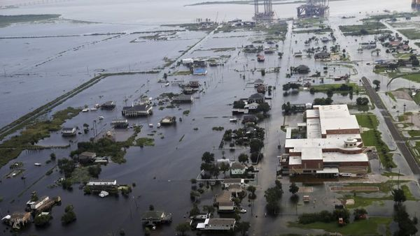 Flooding from Tropical Storm Harvey surrounds buildings in Sabine Pass, Texas, next to the Gulf of Mexico, Thursday, Aug. 31, 2017. (AP Photo/Gerald Herbert)