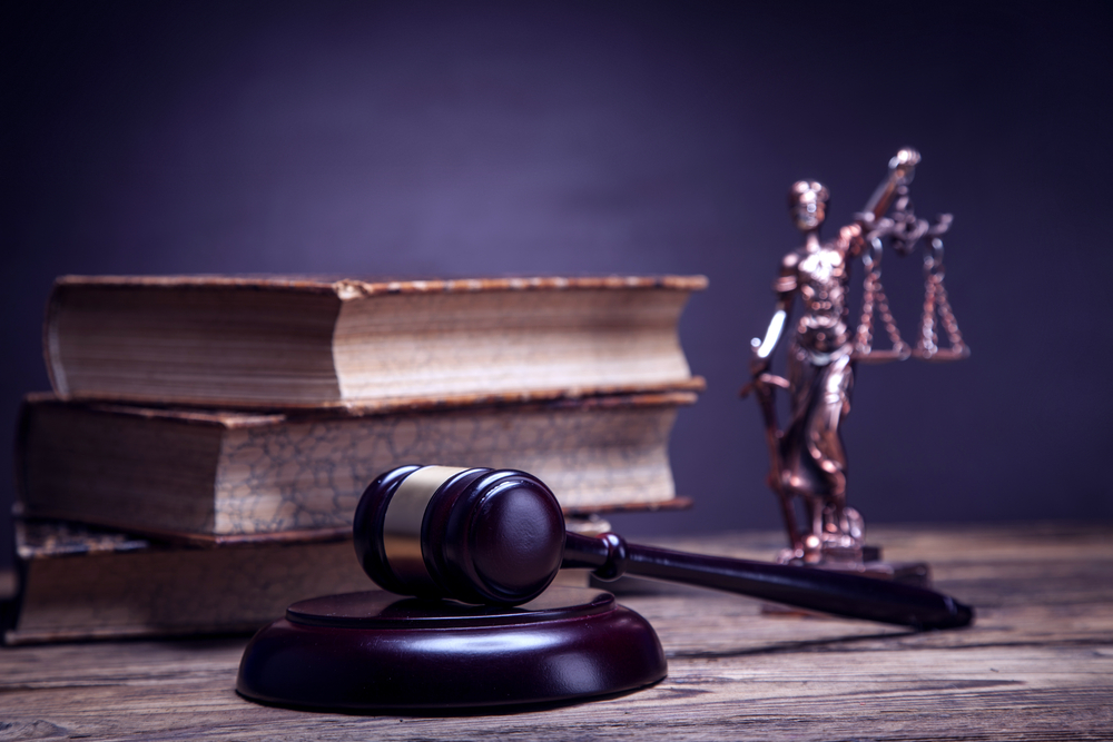 legal motif with gavel and legal books