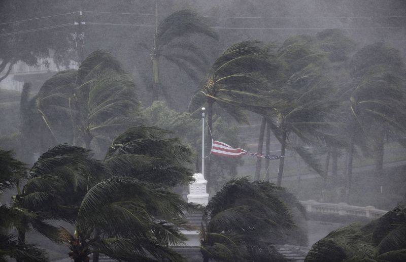 An American flag is torn as Hurricane Irma passes through Naples, Fla.